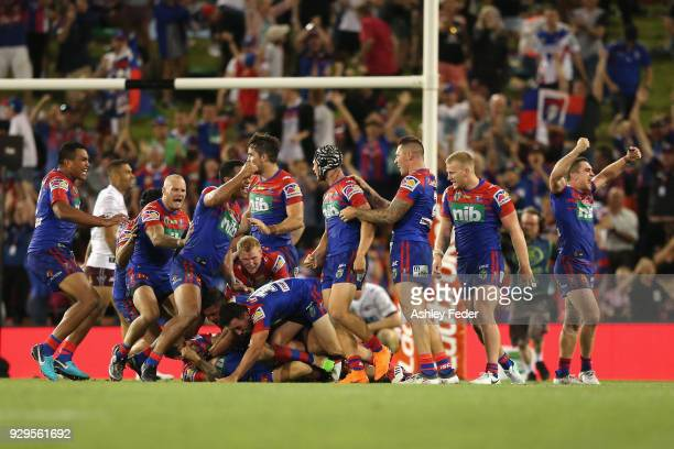 Knights players celebrate the win after Mitchell Pearce scores a field goal during the round one NRL match between the Newcastle Knights and the...