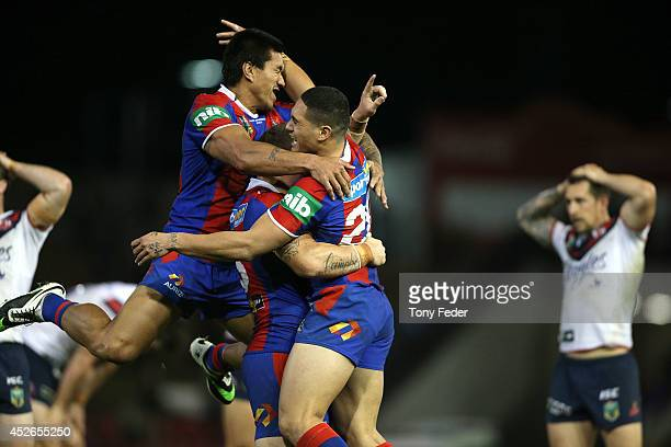 Knights players celebrate the win over the Roosters during the round 20 NRL match between the Newcastle Knights and the Sydney Roosters at Hunter...