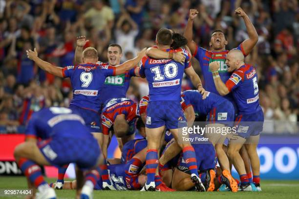 Knights players celebrate the win over the Sea Eagles during the round one NRL match between the Newcastle Knights and the Manly Sea Eagles at...