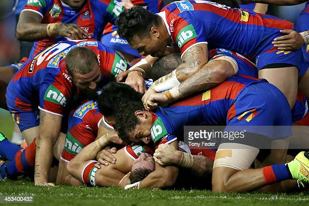 Knights players celebrate the win over the Storm during the round 22 NRL match between the Newcastle Knights and the Melbourne Storm at Hunter...
