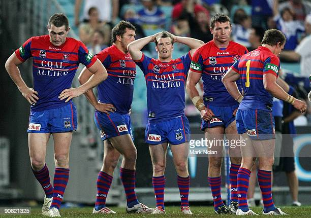 Knights players look dejected after a try by Ben Hannant of the Bullodgs during the third NRL qualifying final match between the Bulldogs and the...
