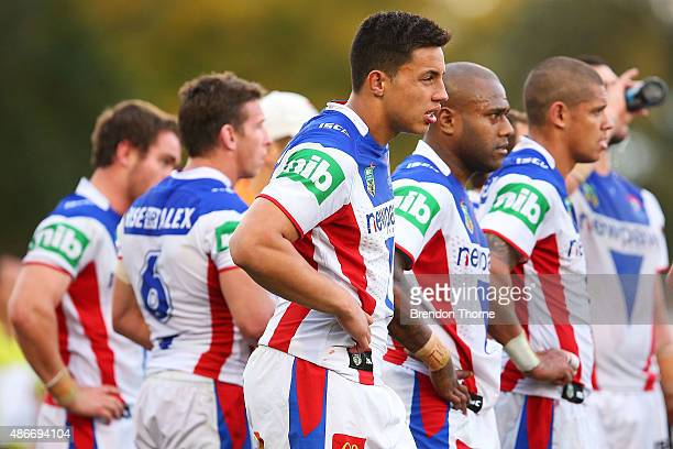 Knights players show their dejection after the Panthers score a try during the round 26 NRL match between the Penrith Panthers and the Newcastle...