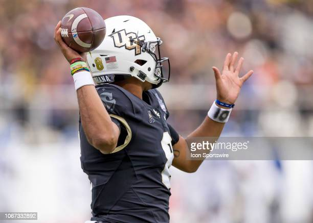 Knights quarterback Darriel Mack Jr passes the ball during the AAC Championship football game between the UCF Knights and the Memphis Tigers on...