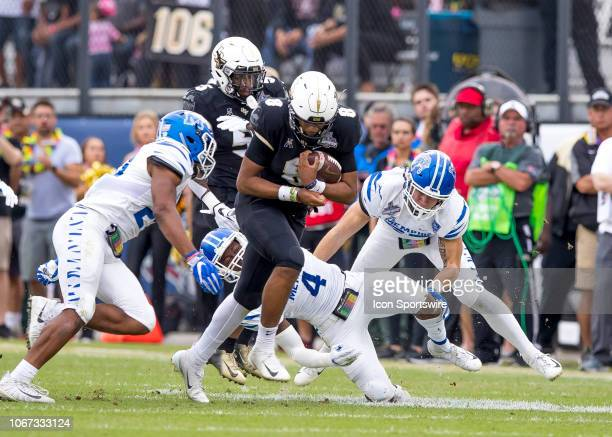 Knights quarterback Darriel Mack Jr runs for a first down during the AAC Championship football game between the UCF Knights and the Memphis Tigers on...
