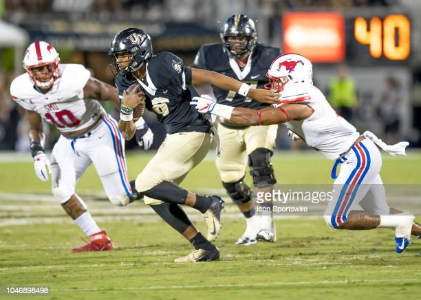 Knights quarterback Darriel Mack Jr runs the ball during the football game between the UCF and SMU on October 6 2018 at Bright House Network Stadium...