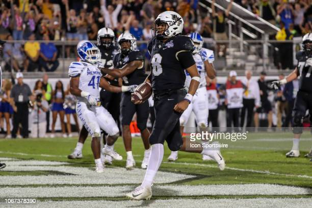 Knights quarterback Darriel Mack Jr scores a touchdown during the AAC Championship football game between the visiting Memphis Tigers and the UCF...