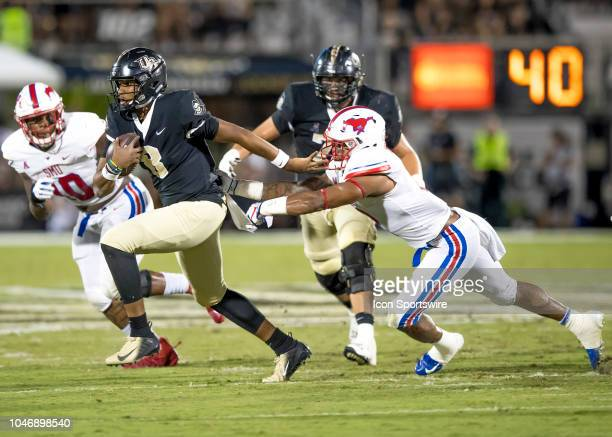 Knights quarterback Darriel Mack Jr substitutes for UCF Knights quarterback McKenzie Milton and runs the ball during the football game between the...
