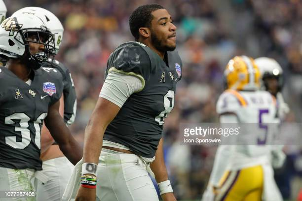 Knights quarterback Darriel Mack Jr walks off the field during the college football game between the UCF Knights and the LSU Tigers on January 1 2019...