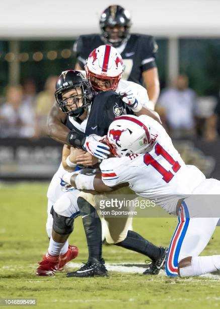 Knights quarterback McKenzie Milton runs the ball and gets injured on the play during the football game between the UCF and SMU on October 6 2018 at...