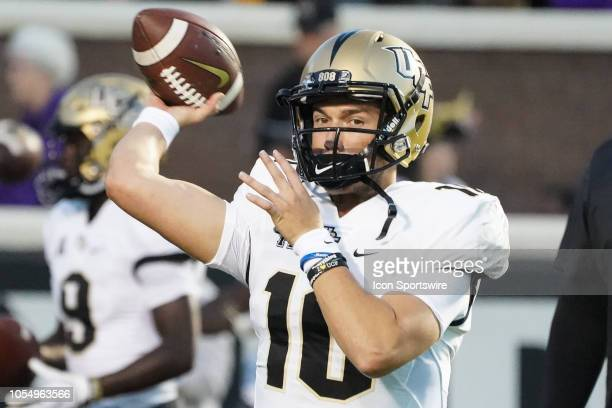 Knights quarterback McKenzie Milton throws a pass in warmups during a game between the UCF Knights and the East Carolina Pirates at DowdyFicklen...