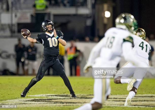 Knights quarterback McKenzie Milton throws for a long first down reception late in the 4th quarter during the football game between the UCF Knights...