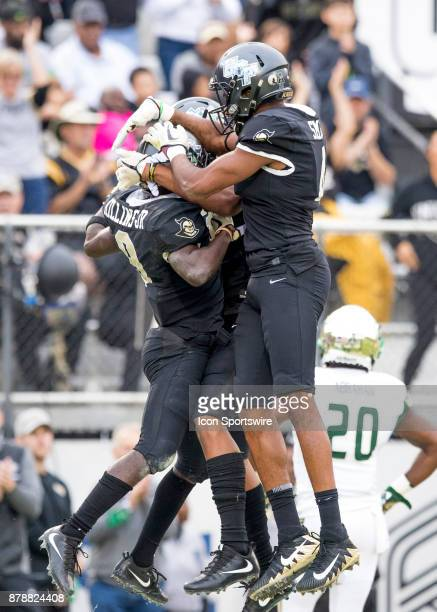 Knights running back Adrian Killins Jr celebrates with teammates after scoring a touchdown during the football game between the UCF Knights and USF...