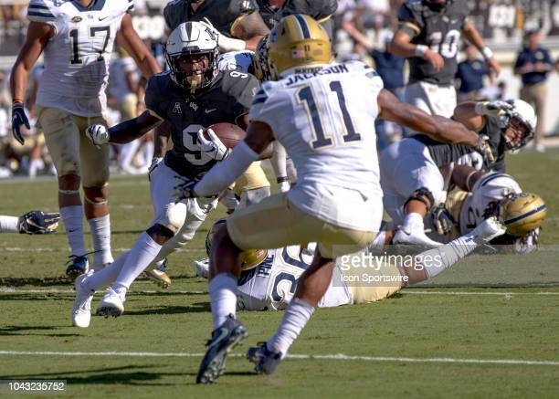 Knights running back Adrian Killins Jr runs the ball at Pittsburgh Panthers defensive back Dane Jackson during the football game between the UCF...