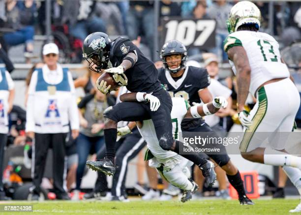 Knights running back Adrian Killins Jr rushes for a touchdown during the football game between the UCF Knights and USF Bulls on November 24 2017 at...