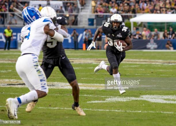 Knights running back Greg McCrae receive a screen pass during the AAC Championship football game between the UCF Knights and the Memphis Tigers on...