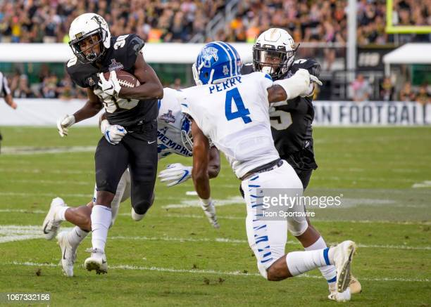 Knights running back Greg McCrae ruins for a first down during the AAC Championship football game between the UCF Knights and the Memphis Tigers on...