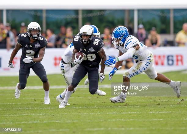 Knights running back Greg McCrae runs the ball during the AAC Championship football game between the UCF Knights and the Memphis Tigers on December 1...
