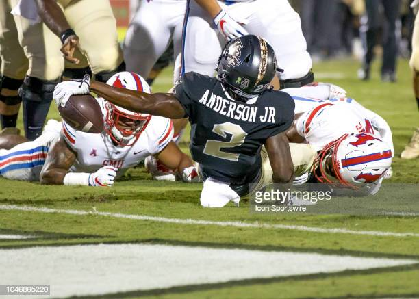 Knights running back Otis Anderson reaches across the goal line for a touchdown during the football game between the UCF and SMU on October 6 2018 at...