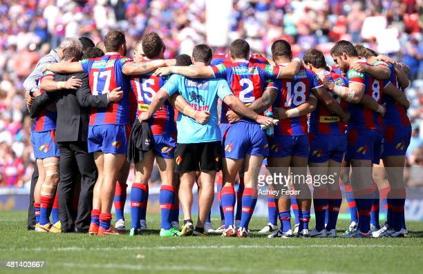 Knights teammates huddle during a tribute to Alex McKinnon during the round four NRL match between the Newcastle Knights and the Cronulla Sutherland...