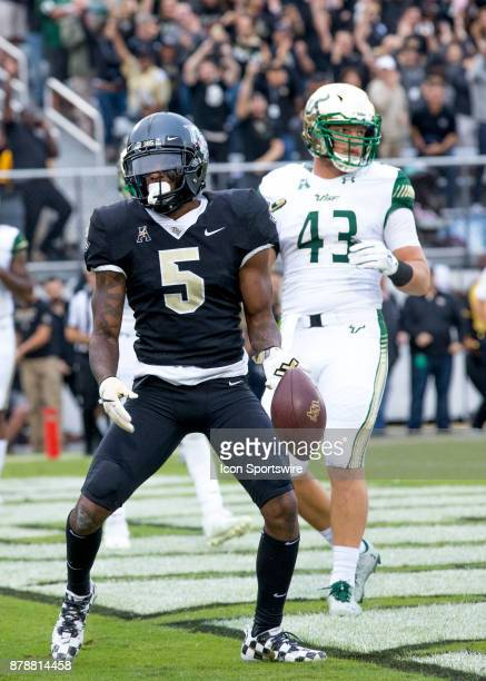 Knights wide receiver Dredrick Snelson celebrates his touchdown during the football game between the UCF Knights and USF Bulls on November 24 2017 at...