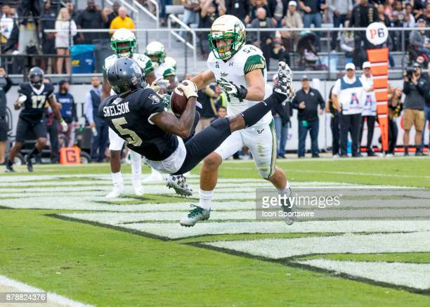 Knights wide receiver Dredrick Snelson scores a touchdown during the football game between the UCF Knights and USF Bulls on November 24 2017 at...