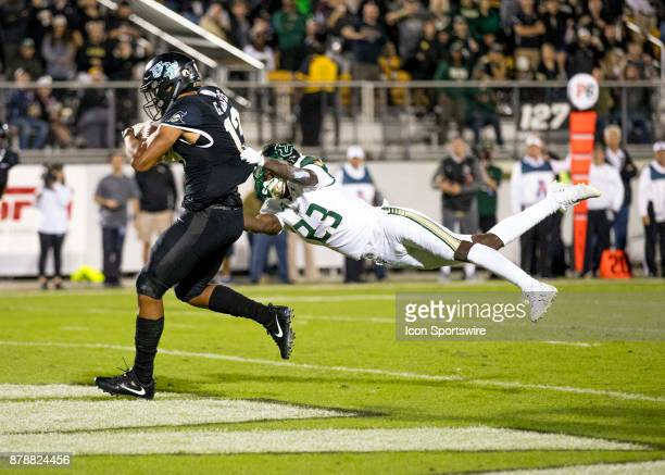 Knights wide receiver Gabriel Davis scores a touchdown as South Florida Bulls cornerback Mazzi Wilkins grabs him during the football game between the...