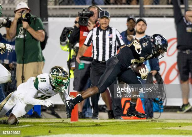 Knights wide receiver Otis Anderson scores a touchdown during the football game between the UCF Knights and USF Bulls on November 24 2017 at Bright...