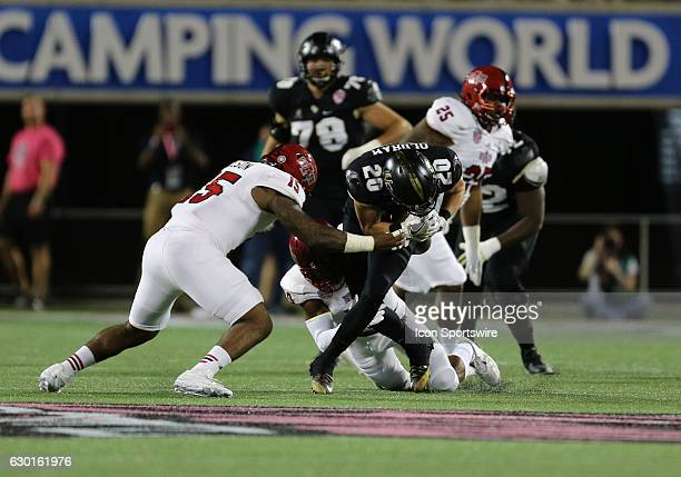 Knights wide receiver Taylor Oldham is tackled after catching a pass during the Cure Bowl between the UCF Knights and Arkansas State Red Wolves on...