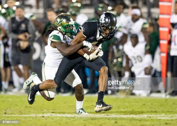 Knights wide receiver Tre'Quan Smith runs for extra yards during the football game between the UCF Knights and USF Bulls on November 24 2017 at...