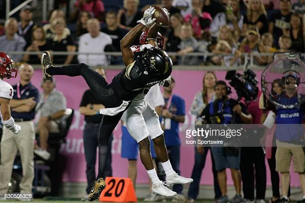 Knights wide receiver TreQuan Smith snags a pass over Arkansas State Red Wolves cornerback Chris Humes during the AutoNation Cure Bowl on December 17...