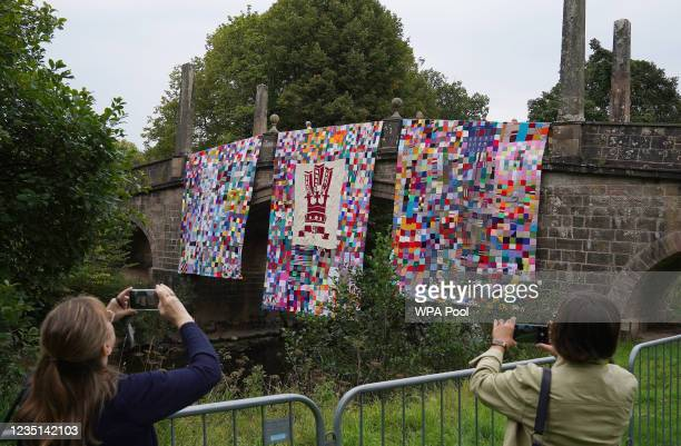 Knitted art installation hangs from a bridge after being unveiled by Prince Charles, The Prince of Wales and Camilla, the Duchess of Cornwall, known...