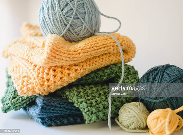 knitted blankets and balls of yarn - knitting stock pictures, royalty-free photos & images