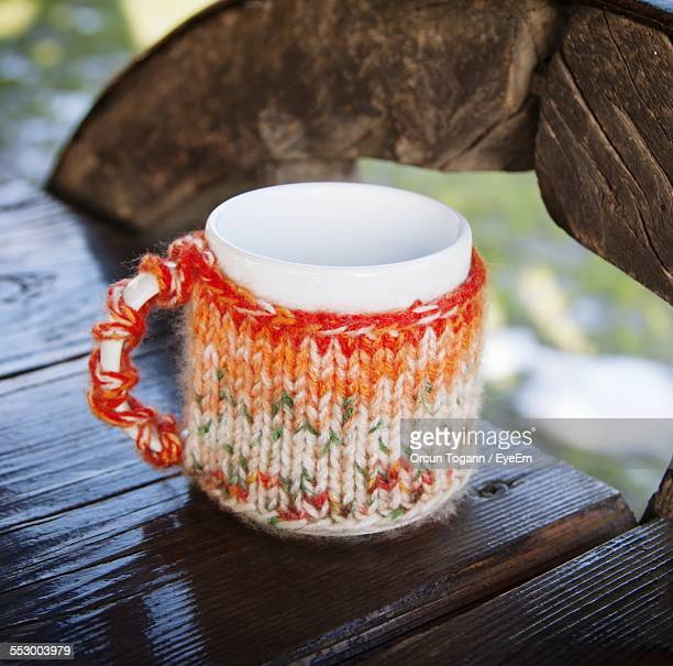Knitted Coffee Cup On Table