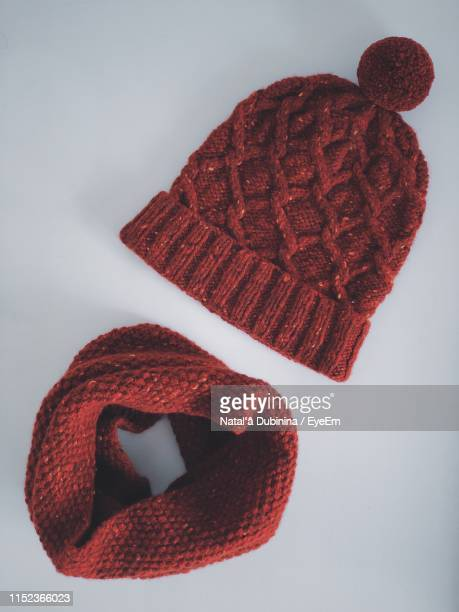 knitted hat and scarf on white background - knit hat stock pictures, royalty-free photos & images