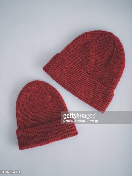 knitted hats on white background - woolly hat stock pictures, royalty-free photos & images