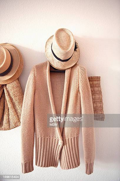 Knitted sweater and hat on hook