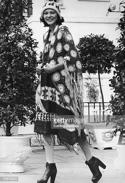 A knitted woolen dress and hat worn with a crocheted shawl June 1974
