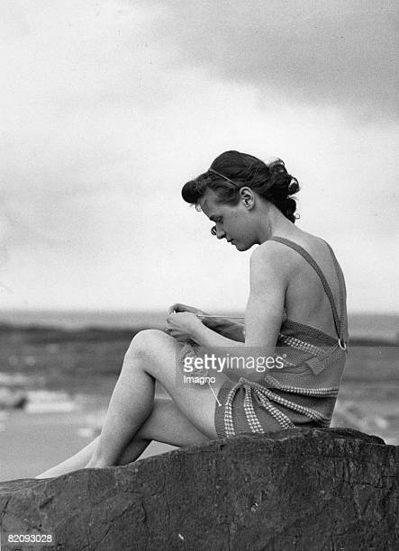 A knitting girl at a deserted beach in North Berwick Photograph England April 6th 1935 [Ein strickendes Mdchen an einem leeren Strand in North...
