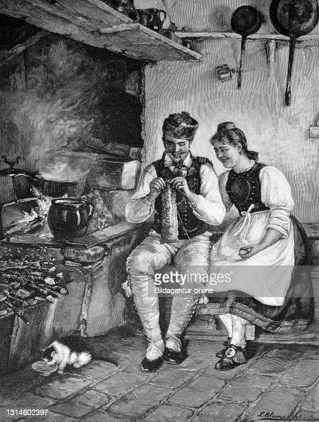 Knitting lessons, Young woman tries to teach her husband to knit, both sitting next to the stove in a rural room, Austria, 1884 / Strickunterricht,...