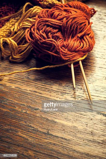 Knitting Needles and Yarn on Wood