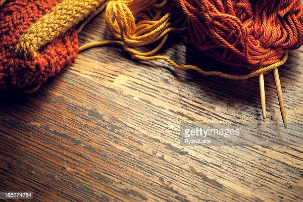 Knitting Needles and Yarn on Wood