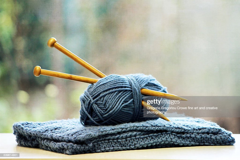Knitting needles in ball of yarn : Stock Photo