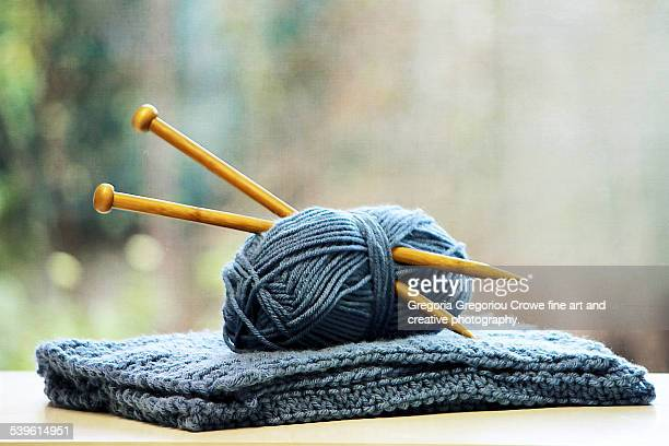 Knitting needles in ball of yarn