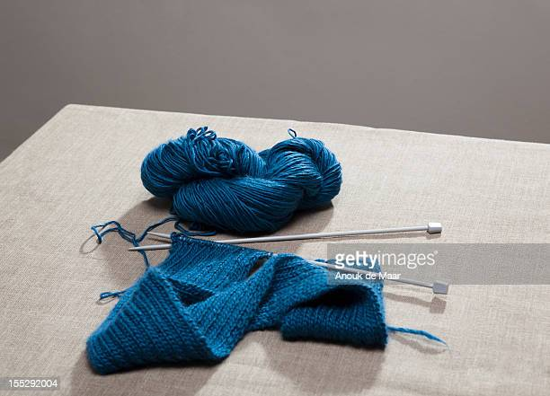 Knitting on needles attached to yarn
