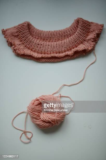 knitting project in peachy color gone wrong, seen on a white background - kristina strasunske stock pictures, royalty-free photos & images