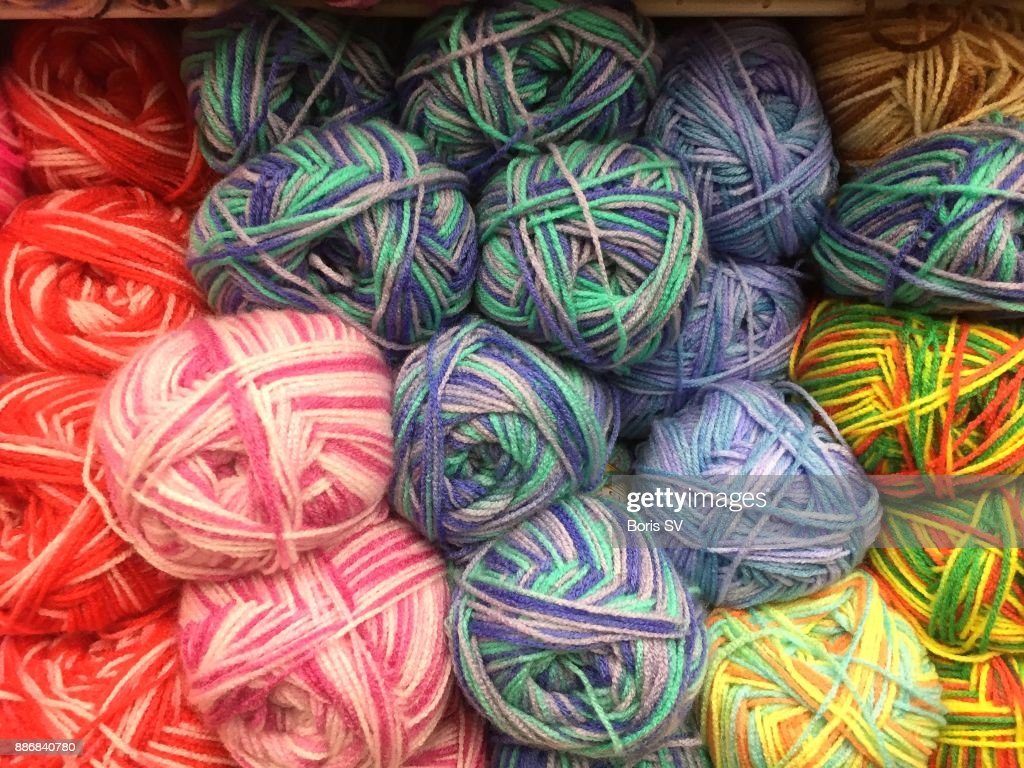 Knitting wool yarns with mixed colors : Stock Photo