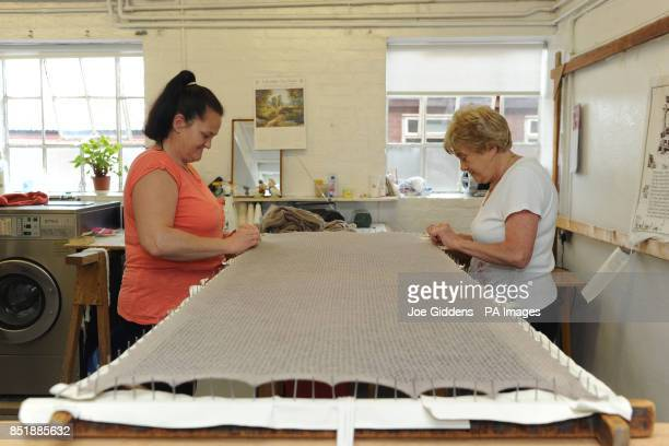 Knitwear finishers Dawn Hart and Irene Wilson work on a merino wool shawl at GH Hurt Son in Chilwell Nottinghamshire The superfine merino wool...
