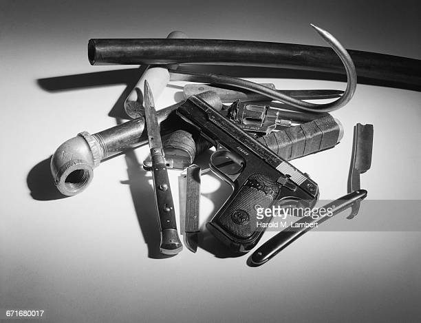 """ knives and handgun, close-up"" - {{ contactusnotification.cta }} stock pictures, royalty-free photos & images"