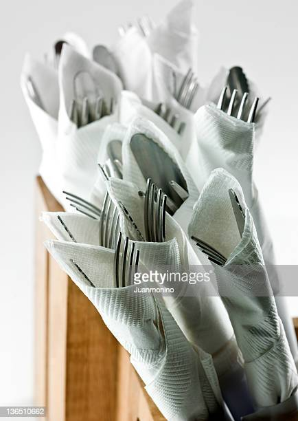 knives, forks, and napkins - paper napkin stock photos and pictures