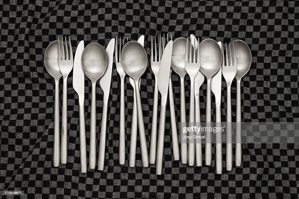 Knives, forks and spoons on dishcloth : Stock Photo